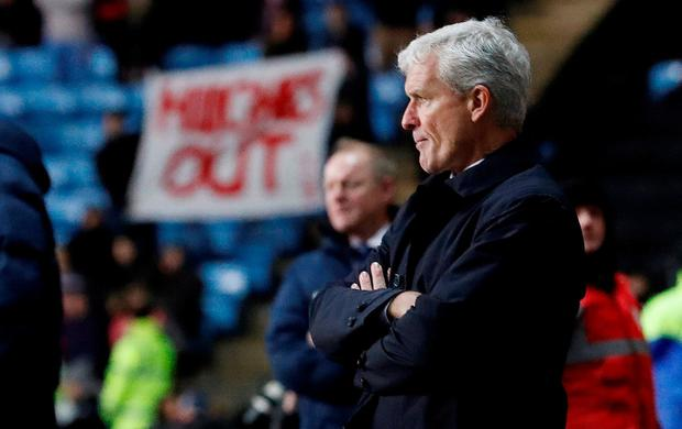 Stoke City manager Mark Hughes looks dejected