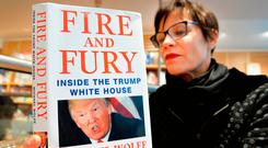 Asa Kallen-Lindh, from Sweden, reads her copy of 'Fire and Fury', Michael Wolff's explosive new book on US President Donald Trump, in the Waterstones store in Piccadilly, central London. Photo: PA