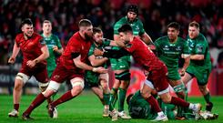 Caolin Blade of Connacht is tackled by Conor Murray and Darren O'Shea of Munster during the Guinness PRO14 Round 13 match between Munster and Connacht at Thomond Park in Limerick. Photo by Matt Browne/Sportsfile