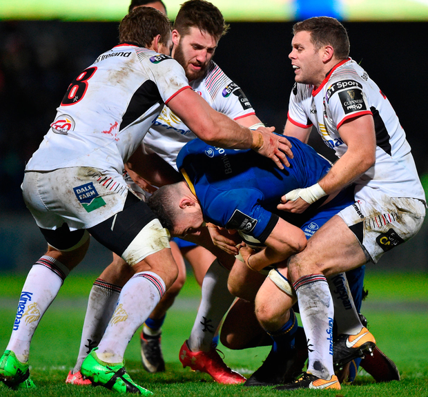 Leinster's Josh Murphy is tackled by, from left, Jean Deysel, Stuart McCloskey and Darren Cave of Ulster. Photo: David Fitzgerald/Sportsfile