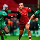 Simon Zebo of Munster in action against Niyi Adeolokun, left, and Tiernan O'Halloran of Connacht during the Guinness PRO14 Round 13 match between Munster and Connacht at Thomond Park in Limerick. Photo by Diarmuid Greene/Sportsfile