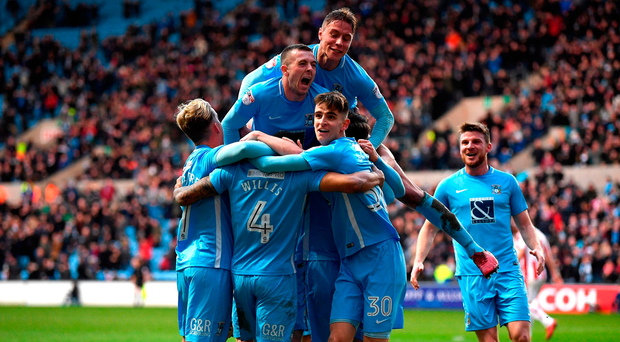Jordan Willis of Coventry City celebrates with teammates after scoring his sides first goal Photo: Getty