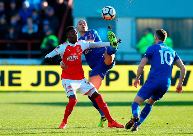 Devante Cole of Fleetwood Town and Yohan Benalouane of Leicester City battle for the ball Photo: Getty