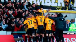 Newport County's Shawn McCoulsky (centre) celebrates scoring his side's second goal of the game with team-mates during the Emirates FA Cup, Third Round match at Rodney Parade, Newport. David Davies/PA Wire.