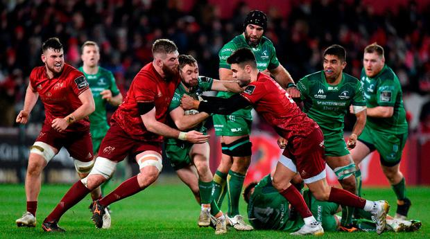 Connacht's Caolin Blade is tackled by Conor Murray and Darren O'Shea. Photo: Matt Browne/Sportsfile