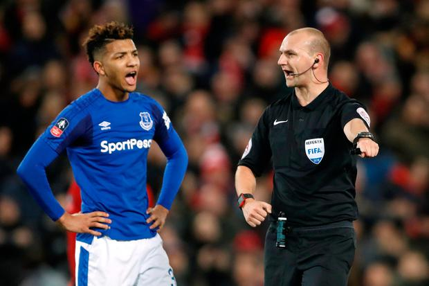 Referee Robert Madley awards a penalty to Liverpool after Everton's Mason Holgate is deemed to have brought down Adam Lallana in the area. Photo: Action Images via Reuters/Carl Recine
