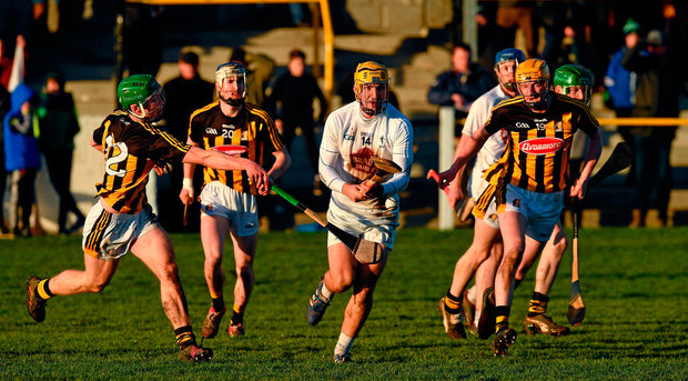 Martin Fitzgerald of Kildare in action against Martin Keoghan, left, and Sean Morrissey of Kilkenny. Photo by Ray McManus/Sportsfile