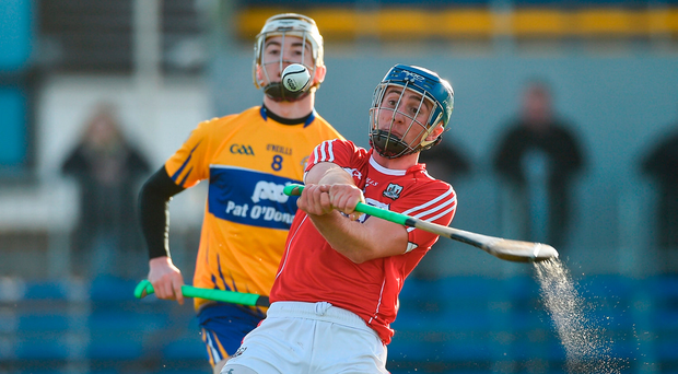 Cork's Robert O'Shea in action against Clare's Ryan Taylor. Photo by Diarmuid Greene/Sportsfile