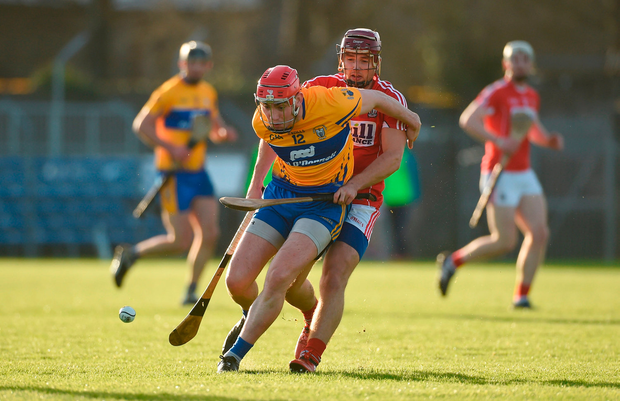 Niall Deasy of Clare in action against Richard Cahalane of Cork. Photo by Diarmuid Greene/Sportsfile