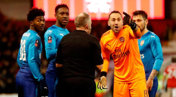 David Ospina leads the Arsenal protests to referee Jon Moss after Nottingham Forest's fourth goal. Photo: Action Images via Reuters/Carl Recine