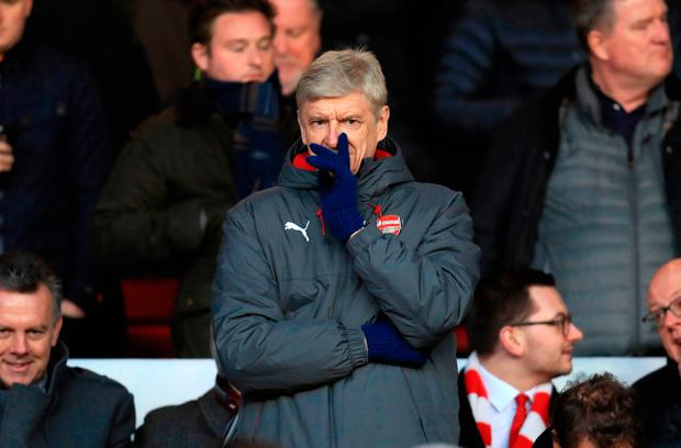 Arsenal manager Arsene Wenger pictured in the stands at the City Ground, Nottingham. Photo: PA