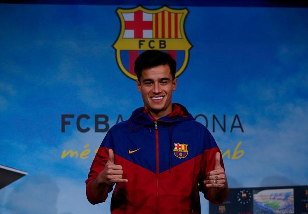 Philippe Coutinho is all smiles in Barcelona yesterday ahead of the completion of his £145million move from Liverpool. Photo: REUTERS/Albert Gea