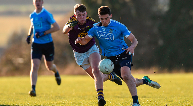 Dublin's Colm Basquel battles Mark O'Neill of Wexford in yesterday's Bord na Mona O'Byrne Cup clash. Photo by Matt Browne/Sportsfile