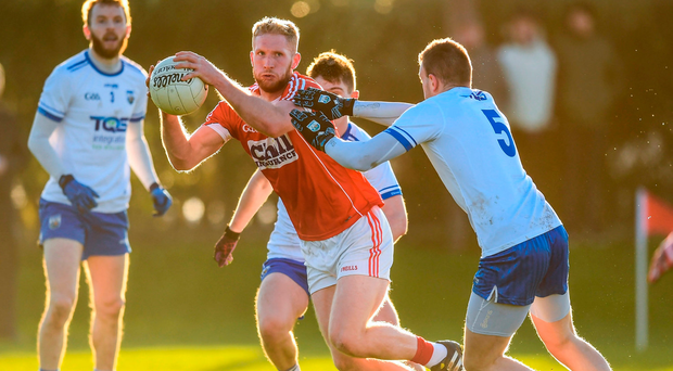 Ruairi Deane of Cork escapes the attentions James McGrath of Waterford in their McGrath Cup clash. Photo by Stephen McCarthy/Sportsfile