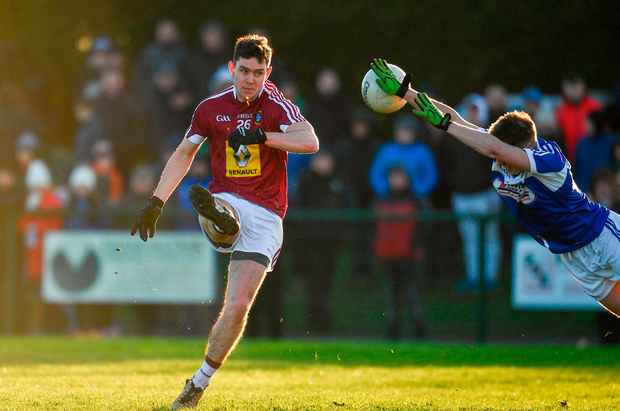 Alex Gardiner of Westmeath has a shot blocked down by Chris Finn of Laois. Photo by Sam Barnes/Sportsfile
