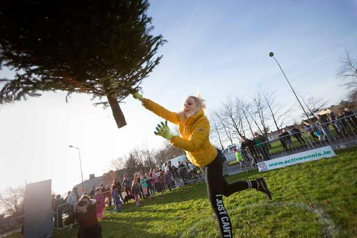 Kamila Grabska from Ennis won the ladies' event at the tree-throwing contest. Photo: Eamon Ward