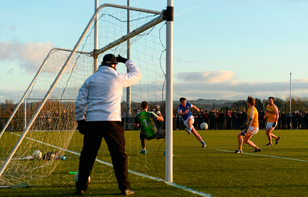Niall McKiernan of Cavan shoots to score his side's second goal of the game. Photo by Ramsey Cardy/Sportsfile