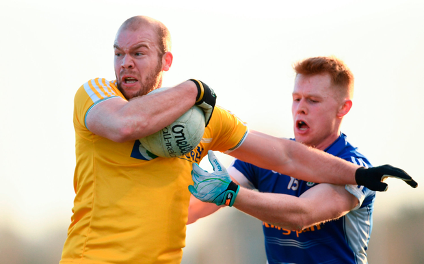 Sean McVeigh of Antrim is tackled by Bryan Magee of Cavan. Photo by Ramsey Cardy/Sportsfile