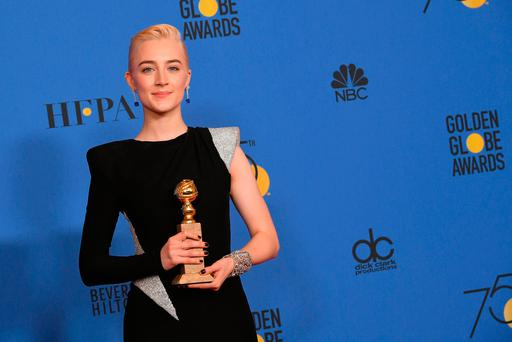 Actress Saoirse Ronan poses with the award for Best Performance by an Actress in a Motion Picture Musical or Comedy in 'Lady Bird' in the press room during The 75th Annual Golden Globe Awards at The Beverly Hilton Hotel on January 7, 2018 in Beverly Hills, California. (Photo by Kevin Winter/Getty Images)