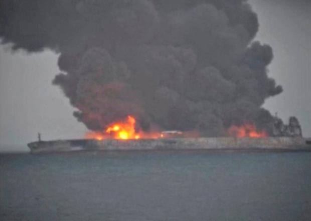 Smoke and fire is seen from Panama-registered tanker SANCHI carrying Iranian oil after it collided with a Chinese freight ship in the East China Sea, in this still image taken from a January 7, 2018 video.