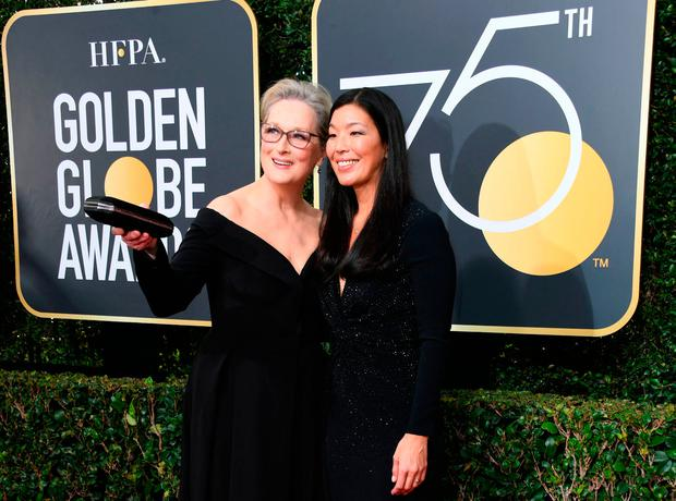 Meryl Streep and Ai-jen Poo, the head of the National Domestic Workers Alliance, arrive for the 75th Golden Globe Awards on January 7, 2018, in Beverly Hills, California. / AFP PHOTO / VALERIE MACONVALERIE MACON/AFP/Getty Images