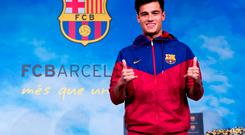Philippe Coutinho poses prior to signing his new contract with FC Barcelona at Camp Nou
