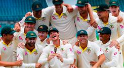 Australia's Steve Smith and team mates celebrate