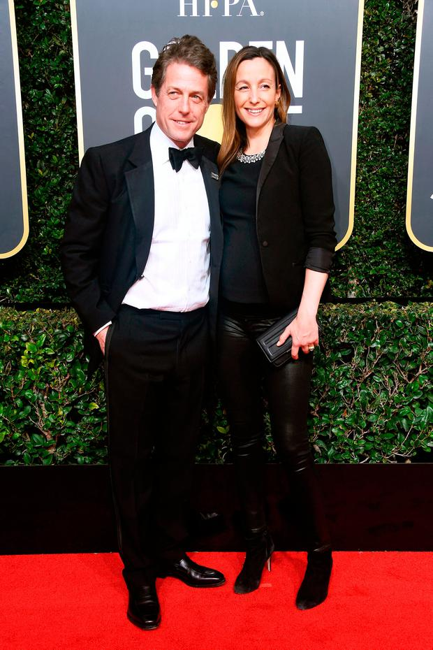 Actor Hugh Grant and Anna Eberstein attend The 75th Annual Golden Globe Awards at The Beverly Hilton Hotel on January 7, 2018 in Beverly Hills, California. (Photo by Frazer Harrison/Getty Images)