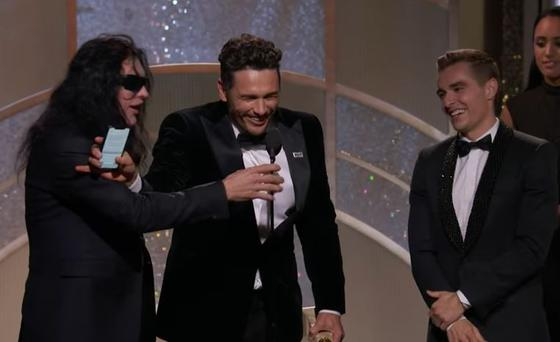 Tommy Wiseau on stage with James and Dave Franco at the Golden Globes