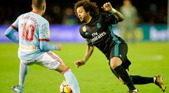 Real Madrid's Marcelo in action with Celta Vigo's Iago Aspas