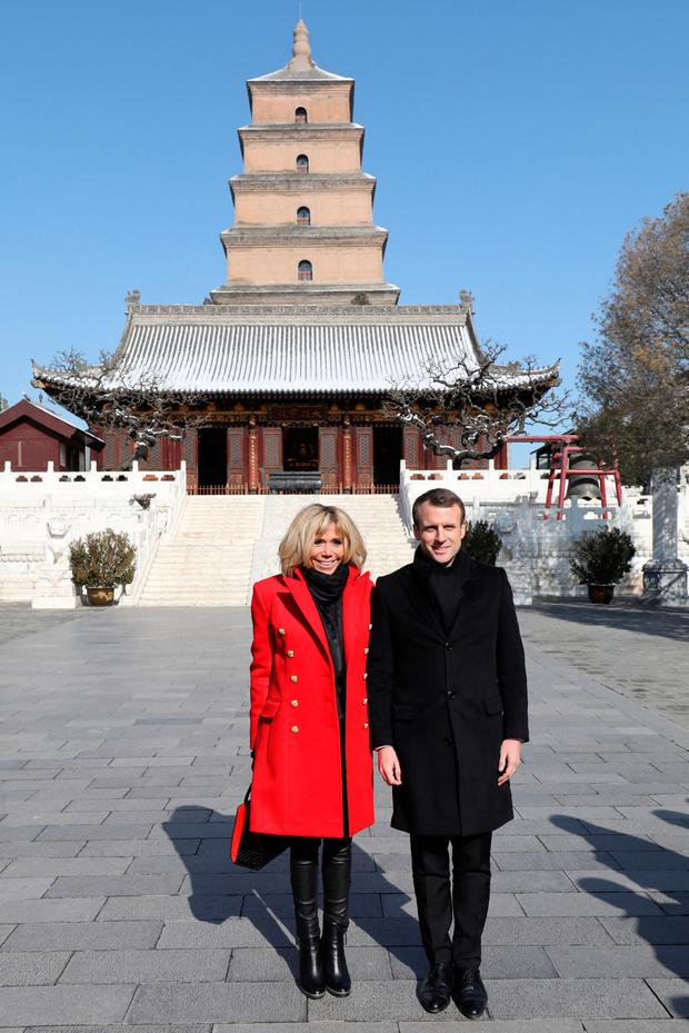 French President Emmanuel Macron and his wife Brigitte Macron pose for a photo during a tour around Big Wild Goose Pagoda in the northern Chinese city of Xian, Shaanxi province, China January 8, 2018. REUTERS/Ludovic Marin/Pool