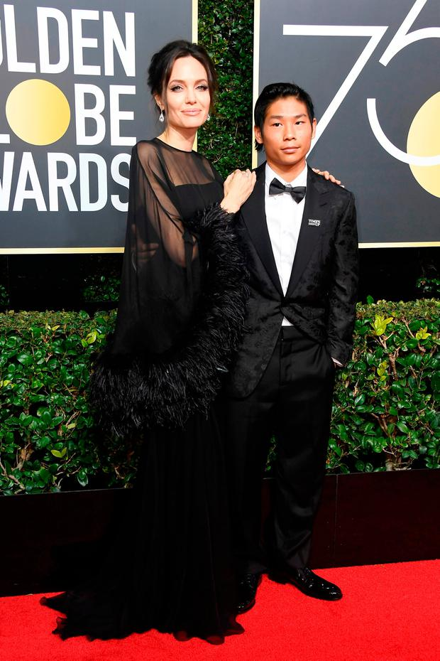 Angelina Jolie (L) and Pax Thien Jolie-Pitt attend The 75th Annual Golden Globe Awards at The Beverly Hilton Hotel on January 7, 2018 in Beverly Hills, California. (Photo by Frazer Harrison/Getty Images)