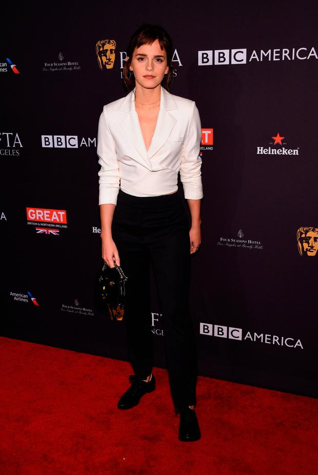 Actress Emma Watson arrives for the BAFTA Los Angeles Awards Season Tea Party at the Four Season Hotel in Beverly Hills, California, on January 6, 2018. / AFP PHOTO / CHRIS DELMASCHRIS DELMAS/AFP/Getty Images