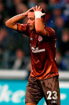 Picture taken on November 5, 2010 shows then St Pauli's striker Deniz Naki reacting during the German first division Bundesliga football match FC Schalke 04 vs FC St Pauli in Gelsenkirchen, western Germany. AFP PHOTO / PATRIK STOLLARZ / ALTERNATIVE CROP PATRIK STOLLARZ/AFP/Getty Images