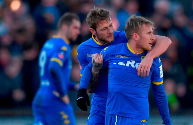 Leeds player Samuel Saiz (21) is held back by team mates after being red carded during The Emirates FA Cup Third Round match between Newport County and Leeds United at Rodney Parade