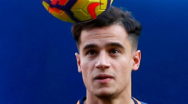 Brazilian soccer player Philippe Coutinho poses for the media at the Camp Nou