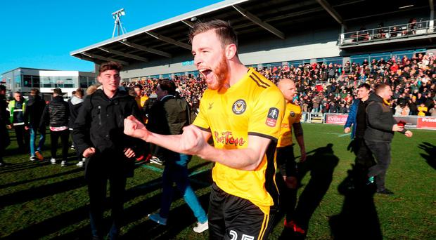 Newport County's Mark O'Brien celebrates victory after the Emirates FA Cup, Third Round match at Rodney Parade