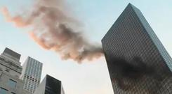 Smoke is seen rising from the roof of Trump Tower Photo: TWITTER/@NYCBMD/via REUTERS