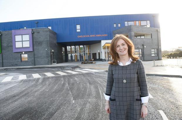 Principal Dairiona Nic Con Iomaire in front of the new school buildingPhoto:Andrew Downes