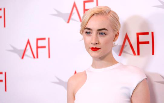Actor Saoirse Ronan poses at the AFI AWARDS 2017 luncheon in Los Angeles, California, U.S., January 5, 2018. REUTERS/Mario Anzuoni