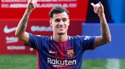 Barcelona's new signing Philippe Coutinho waves on the pitch