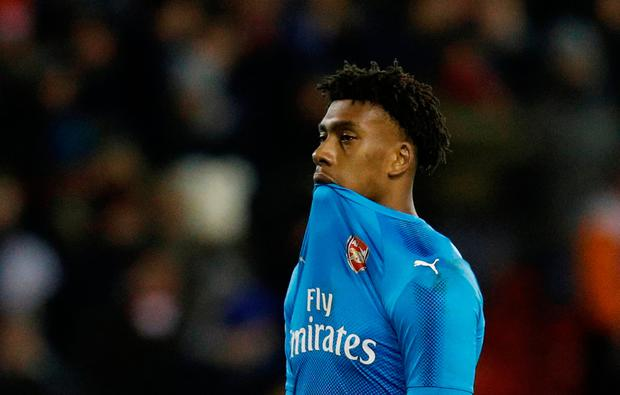 Arsenal's Alex Iwobi looks dejected against Forest