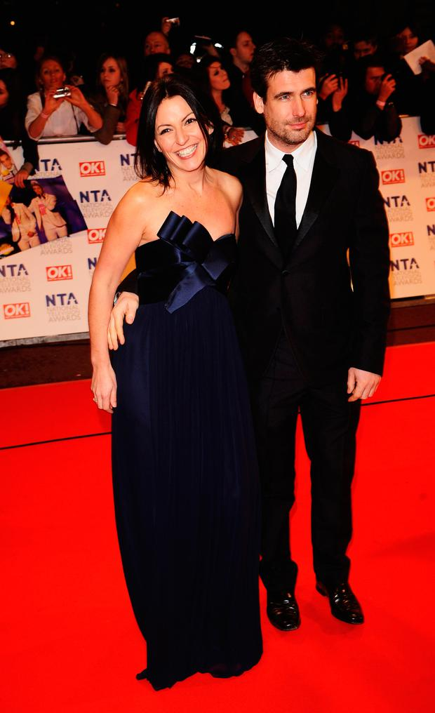 Davina McCall and husband Matthew Robertson arrive at the National Television Awards held at O2 Arena on January 20, 2010 in London, England. (Photo by Ian Gavan/Getty Images)
