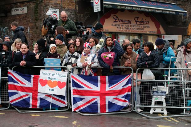 Members of the public wait for the arrival of Prince Harry and Meghan Markle for their visit to youth-orientated radio station, Reprezent FM Yui Mok/PA Wire