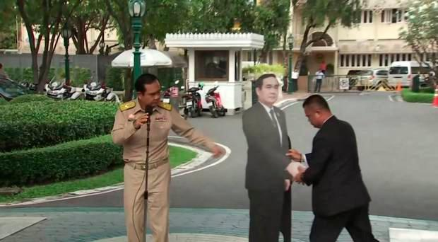 Thai Prime Minister Prayuth Chan-ocha bemused onlookers with his cardboard doppleganger