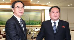 Head of the North Korean delegation, Ri Son Gwon shakes hands with South Korean counterpart Cho Myoung-gyon after their meeting at the truce village of Panmunjom