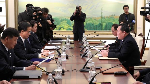 Head of the North Korean delegation, Ri Son Gwon talks with South Korean counterpart Cho Myoung-gyon during their meeting at the truce village of Panmunjom in the demilitarised zone separating the two Koreas