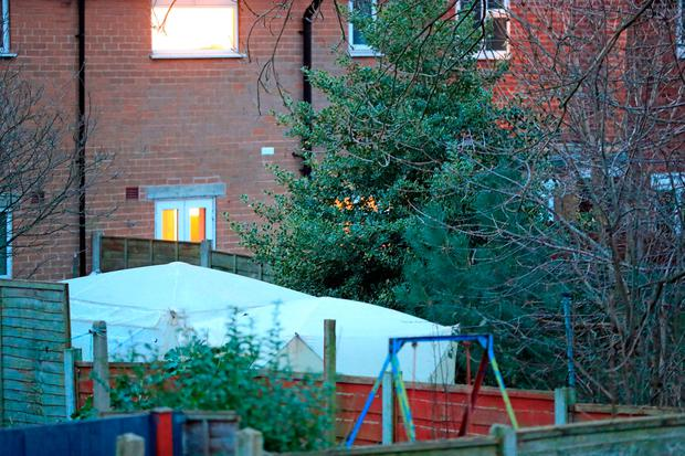 Police tents at the scene of an investigation in the garden of a property on Matlock Road in Reddish, as a woman who has claimed that she killed a man several years ago and buried his body in her back garden has been arrested on suspicion of murder.