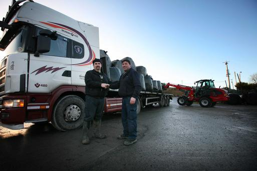 Fodder arrives in Dowra from Tipperary. Eddie Fitzpatrick of Cavan IFA welcomes lorry driver Seamus Gleeson in McMorrow's Timber yard, Dowra with fodder from Tipperary. Photo Brian Farrell