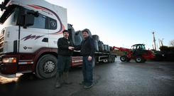 6/1/2018 Fodder arrives in Dowra from Tipperary. Eddie Fitzpatrick of Cavan IFA welcomes lorry driver Seamus Gleeson in McMorrow's Timber yard, Dowra with fodder from Tipperary. Photo Brian Farrell